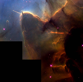 Stellar birthplaces, such as this one in the Eagle nebula are characteristic of the fingers of gas and Proto-stellar matter in M8.
