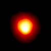 This is the first direct image of a star other than the Sun, made with the Hubble Space Telescope. Called Alpha Orionis, or Betelgeuse, it is a red supergiant star marking the shoulder of the winter constellation Orion the Hunter. The Hubble image reveals a huge ultraviolet atmosphere with a mysterious hot spot on the stellar behemoth's surface. The enormous bright spot, more than ten times the diameter of Earth, is at least 2, 000 Kelvin degrees hotter than the surface of the star.