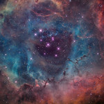 Rosette Nebula lies 5,000 ly away in the constellation Monoceros. It is a faint nebula glowing at magnitude 9.0 and emitting light in the HII region.