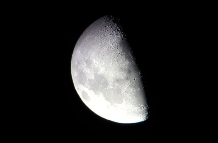 "Photo of Moon taken by Terri Lappin through Orion Starblast 4.5"" telescope with a smartphone."